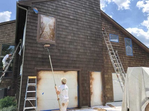During the painting wood siding project