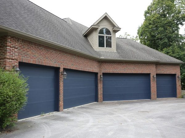 After painting garage doors a beautiful gray-blue