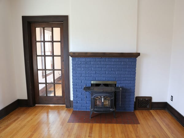 Before painting wood trim white and brick fireplace white