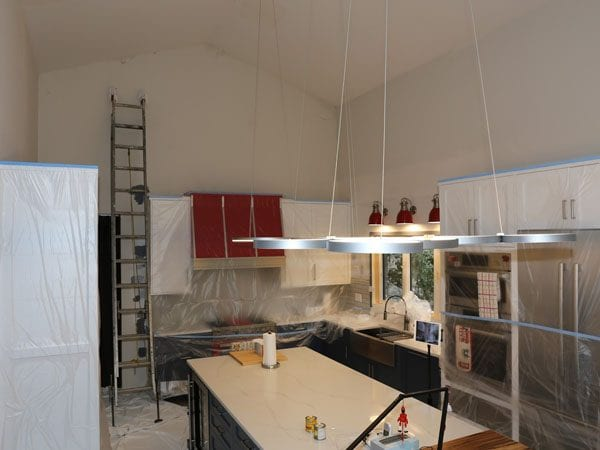 During the process of painting a house interior kitchen