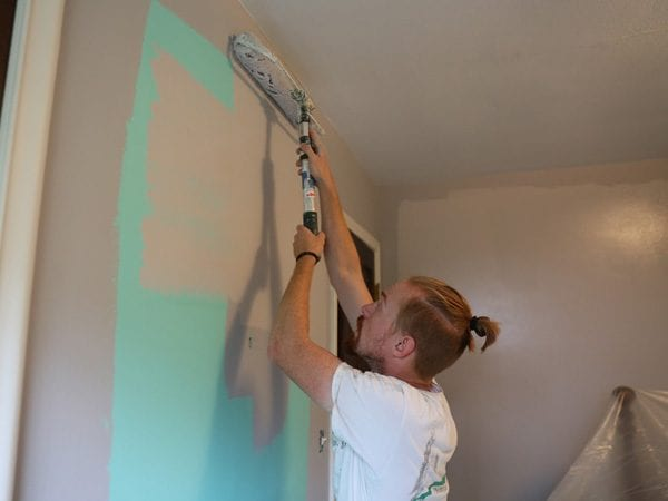 Tribble Painting team member painting a bedroom in Ann Arbor
