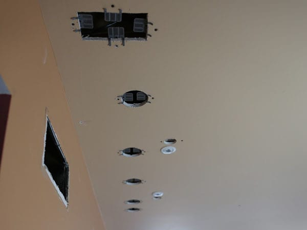 Holes in the ceiling left by lighting installation guy