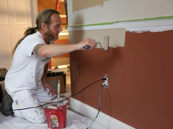 Painting a wall with either Benjamin Moore or Sherwin Williams