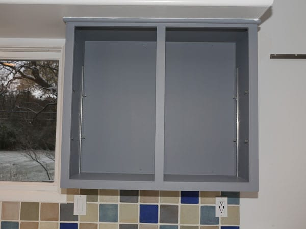 Satin paint sheen used for gray kitchen cabinets