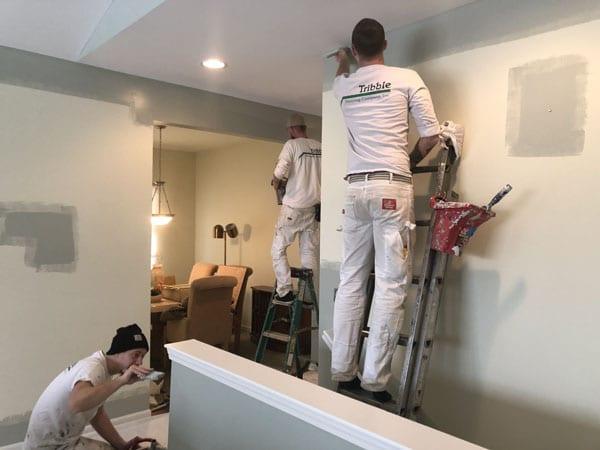 Three man painting team painting an interior