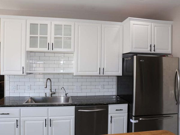 Glossy paint sheen used for white kitchen cabinets
