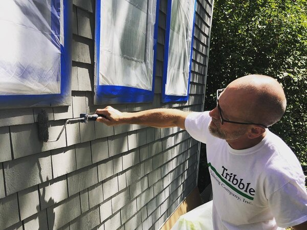 Todd Tribble painting a house exterior