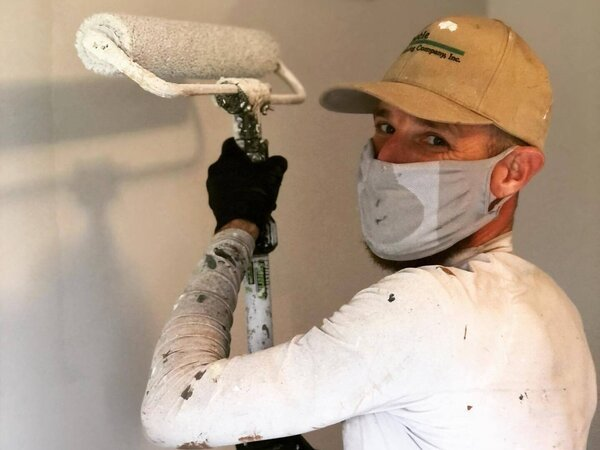 Tribble team member painting a wall