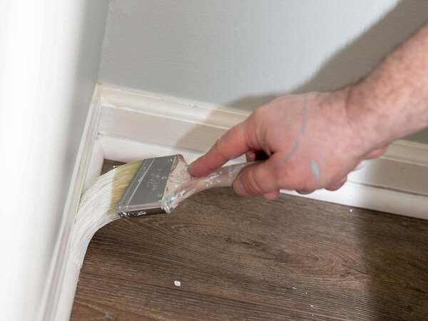 Painting the interior trim of a baseboard