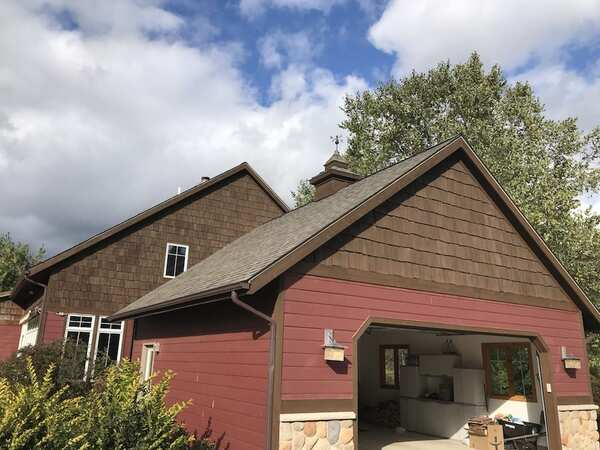 Red and wood stained house exterior