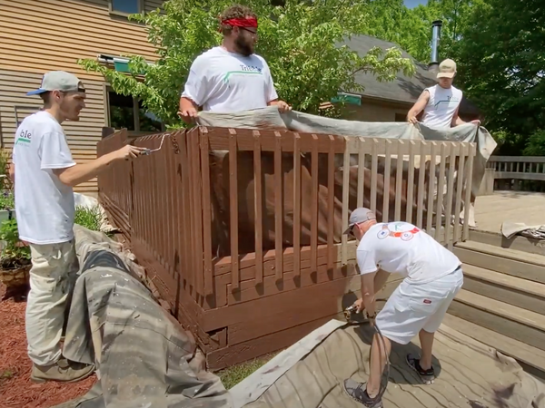 Todd Tribble and team staining a deck