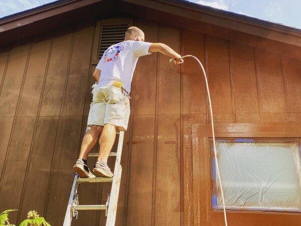 Spraying a home exterior